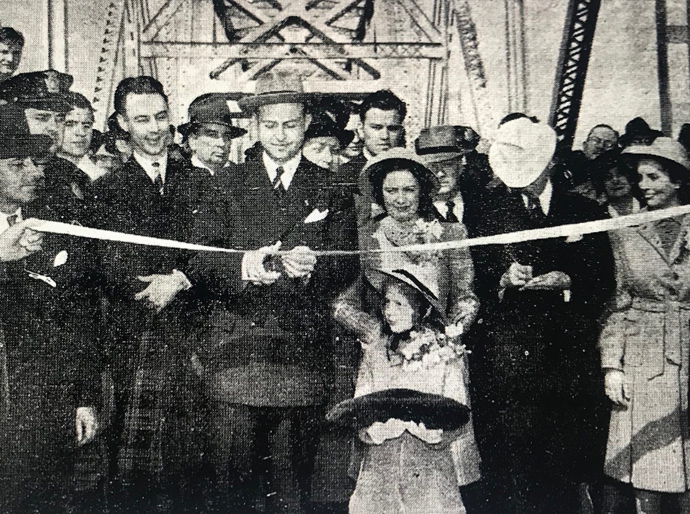 The governors of Indiana, Kentucky and Tennessee celebrate with a huge crowd on the day tolls were lifted on the Ohio River bridge between Evansville and Henderson.