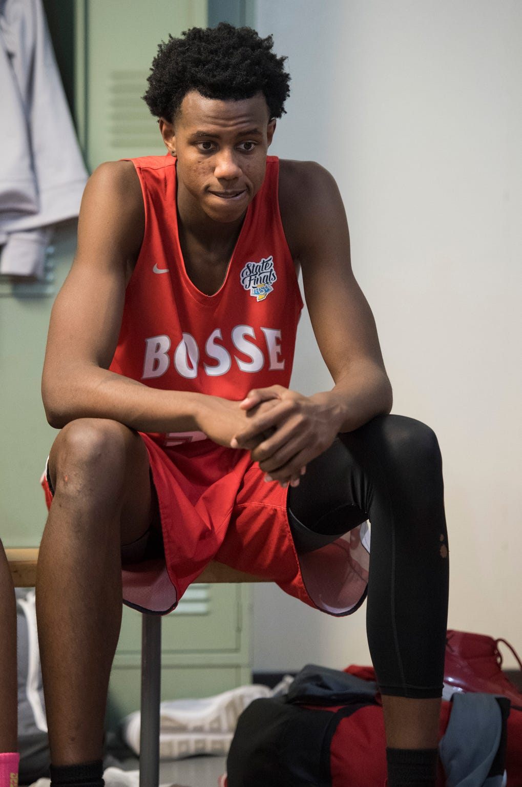 Bosse High School junior Kiyron Powell reflects in the locker room at halftime during the Bosse vs Memorial game Tuesday, Dec. 11, 2018.