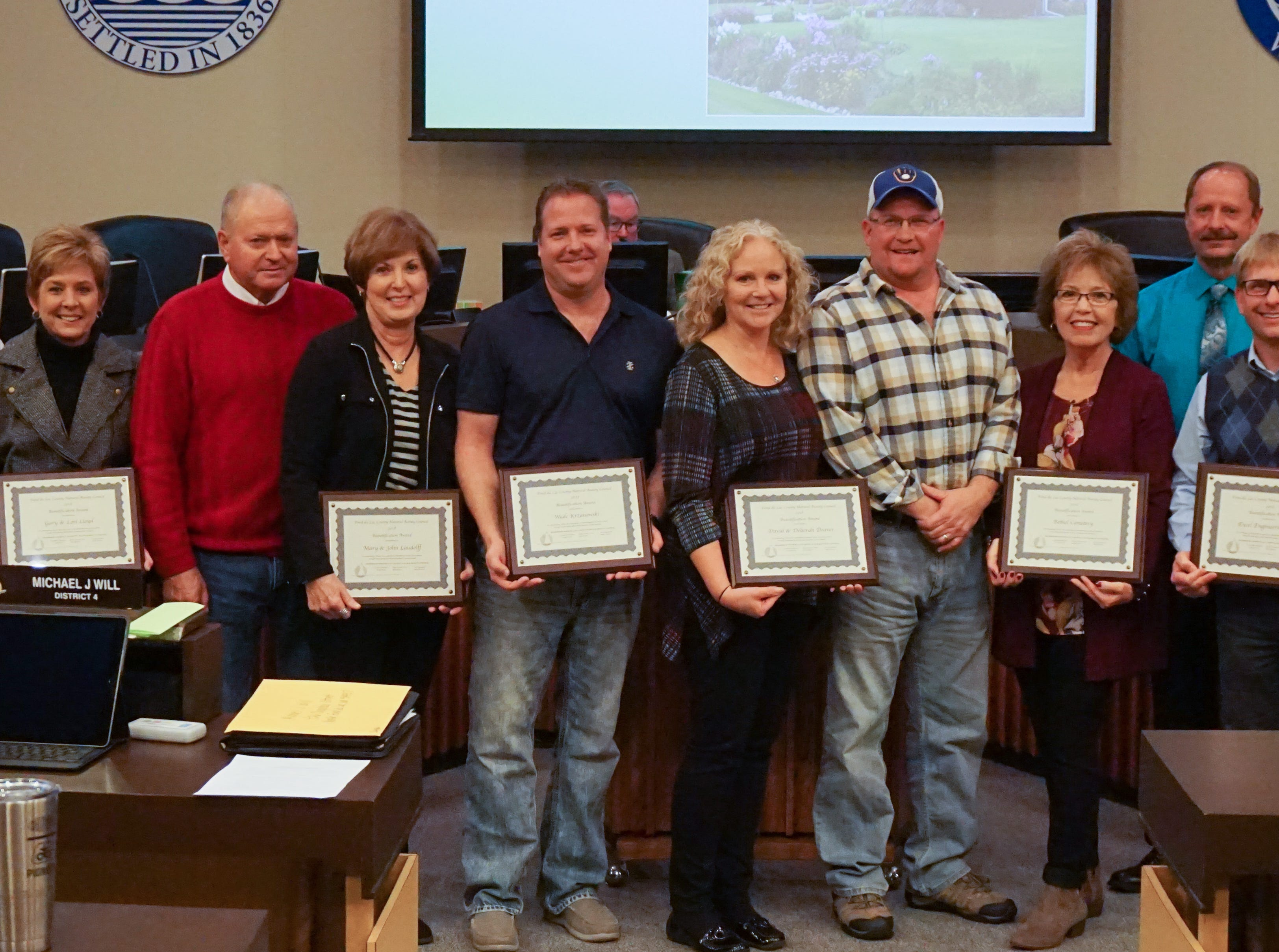 Pictured, from left, Brian Kolstad, chairperson, Natural Beauty Council; Gary and Lori Lloyd; John and Mary Laudolff; Wade Krzanowski; Deborah and David Deaver; Jackie Hansen of Bethel Cemetery; John Rickert, vice chairperson, Natural Beauty Council; Jeff Quast, president, Excel Engineering.