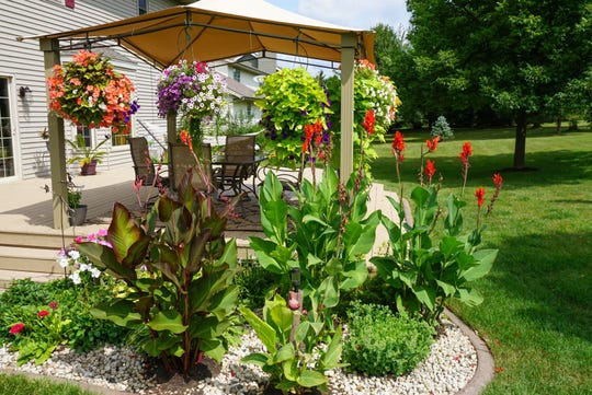 After moving to 983 Churchill Lane in 2008, Wade Krzanowski took on the task of remodeling this City of Fond du Lac home inside and out.  The new deck features a gazebo with hanging flower planters. Colorful landscaping throughout makes the property stand out in this residential neighborhood.