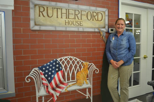 Beth Sage pauses from her work on a yet-to-be completed mural at Rutherford House in Fremont.