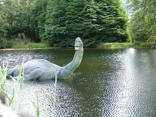 A proposed model of the Loch Ness Monster in front of the Loch Ness Centre and Exhibition building.
