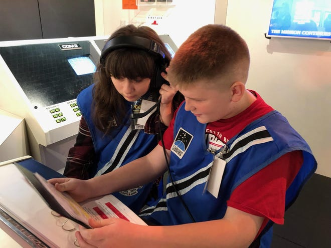 Port Clinton Middle School students Ava DeFreitas and Connor Earnest complete their assignment at the Challenger Learning Center in Oregon, Ohio, during a recent field trip in Diane Zam's Fleet 6 Science class.