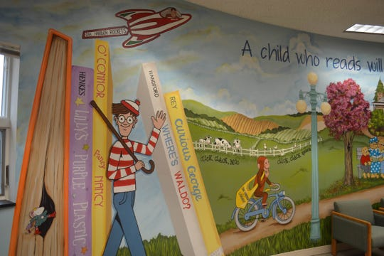 Waldo isn't too hard to find at Oak Harbor Public Library. He and Curious George are part of a children's department mural painted by artist Beth Sage.