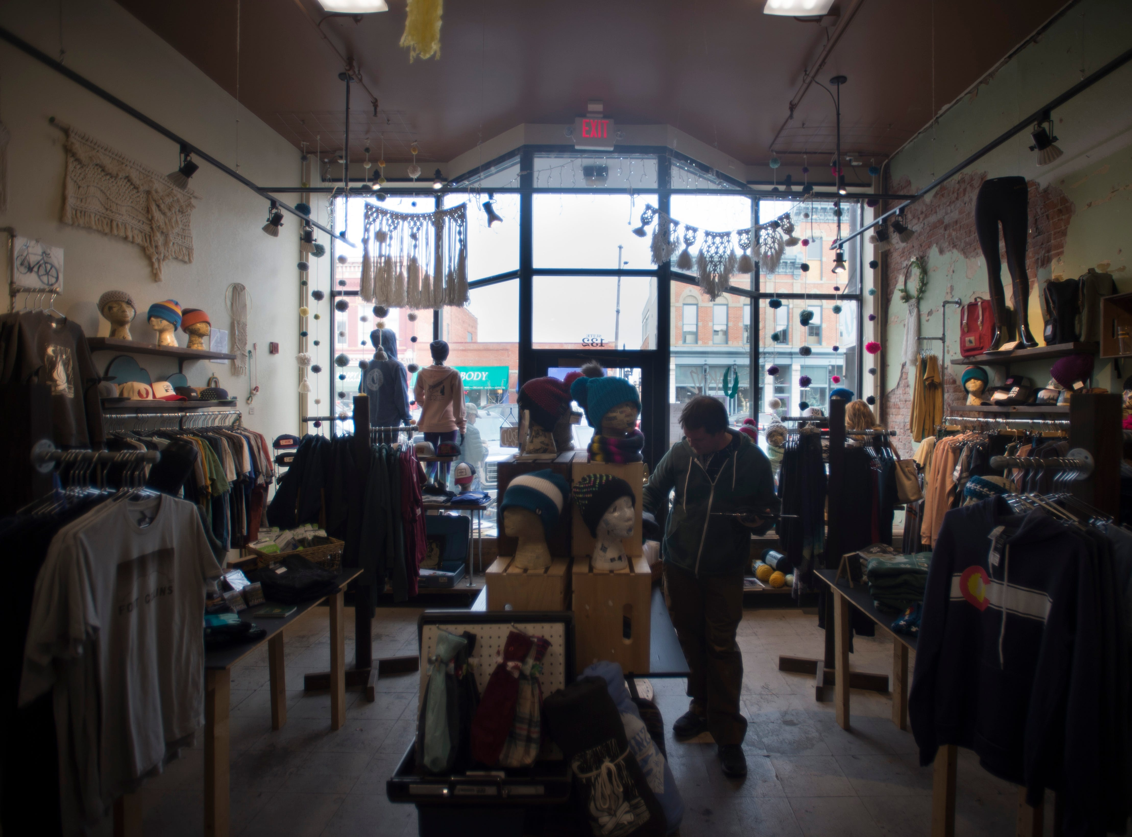 Last-minute holiday shoppers wander Akinz in Old Town on Monday, December 24, 2018.