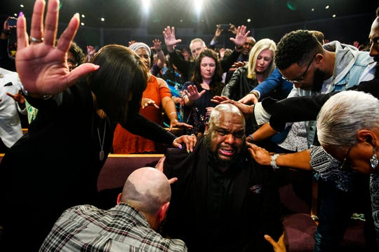 Pastor John Gray is overcome with emotion as he is welcomed in as the new pastor of Relentless Church on Sunday, May 6, 2018. Gray is taking over the former Redemption Church space as Pastors Ron and Hope Carpenter move to San Jose, Calif.