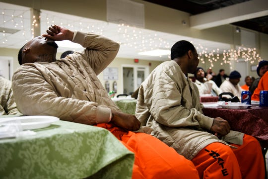 Inmates at Perry Correctional Institute laugh during a Christmas dinner on Monday, Dec. 10, 2018.