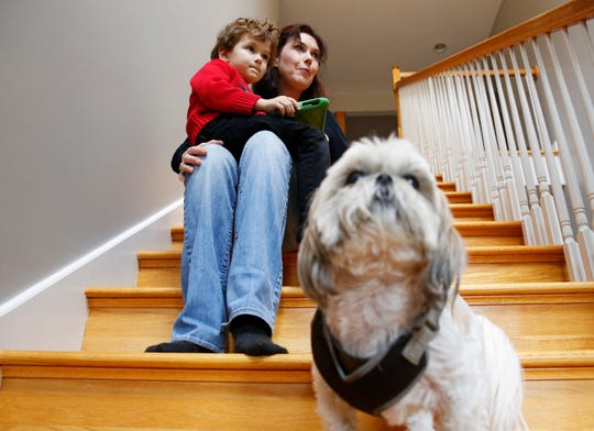Kimilee Bryant holds her son Aidan Bryant, 4, while they and their dog, Gypsy, sit for a photograph in their home in Greenville County Thursday, Nov. 15, 2018.