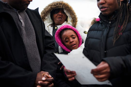 Jekeriah Massey, 8, cries as her aunt, Tamika Gordon, reads a poem she wrote for her father, Jermaine Massey, during a vigil for him outside of his home on Wednesday, March 21, 2018. Massey was fatally shot by Greenville County Sheriff's Office deputies Monday night outside of his home.