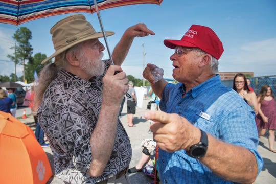Trump protestor Jon Harrison of West Columbia and Trump supporter Terry Cagle of Lexington get in a yelling match outside of Airport High School as people gather in anticipation for President Donald Trump's arrival to campaign for Governor Henry McMaster on Monday, June 25, 2018.