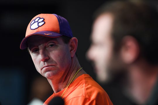 Clemson head coach Dabo Swinney listens as wide receiver Hunter Renfrow answers a question during the Tigers Cotton Bowl press conference at AT&T Stadium in Arlington, TX Monday, December 24, 2018.