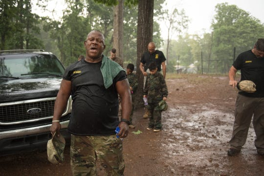 Drill Sergeant Steven Sullivan says a prayer after finishing up bootcamp in the rain outside of Quest Leadership Academy in Greenville on Thursday, May 10, 2018. Sullivan started Strap Em Up Bootcamp in 2011 to try and help kids from different backgrounds combat drugs, teach respect, and promote a healthy lifestyle.