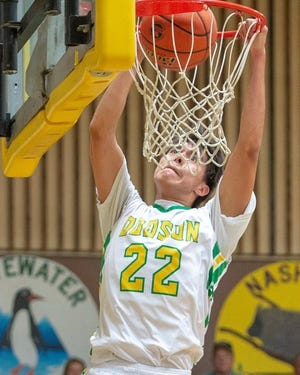 Corbin Lonebear, shown flushing home a dunk earlier this season, set a new Dodson High School record with 45 points in a single game against Nashua last week.