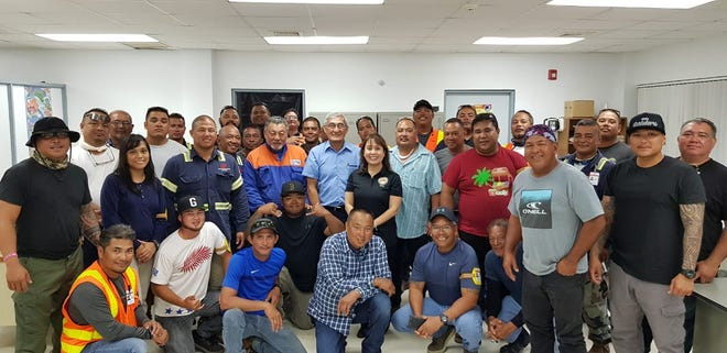 Guam Power Authority employees who have been working in the Commonwealth of the Northern Mariana Islands to help with power restoration are back on island to celebrate Christmas.