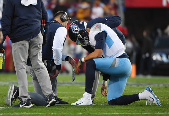 Tennessee Titans quarterback Marcus Mariota (8) talks with head coach Mike Vrabel after an injury during the first half against the Washington Redskins at Nissan Stadium.