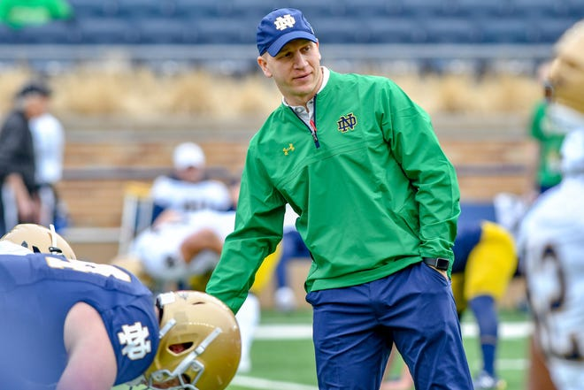 Fighting Irish defensive coordinator Clark Lea watches warmups before the Blue-Gold Game at Notre Dame Stadium.