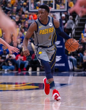 Pacers guard Victor Oladipo (4) moves the ball around the court during an NBA basketball game against the Washington Wizards, Sunday, Dec. 23, 2018, in Indianapolis. Indiana Pacers won, 105-89.