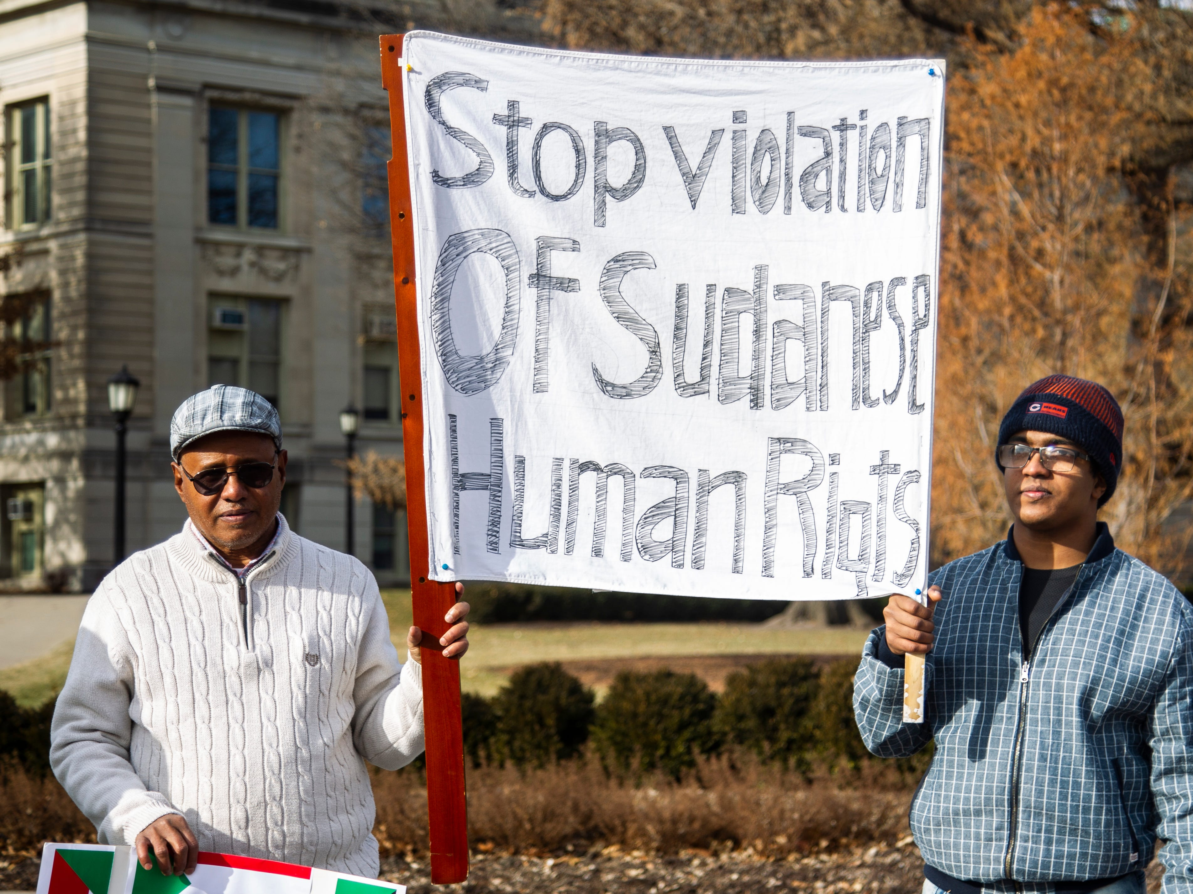 Sudanese members of the Iowa City community gather during a peaceful protest in opposition to the killings in their home country on Monday, Dec. 24, 2018, along the Pentacrest in downtown Iowa City.