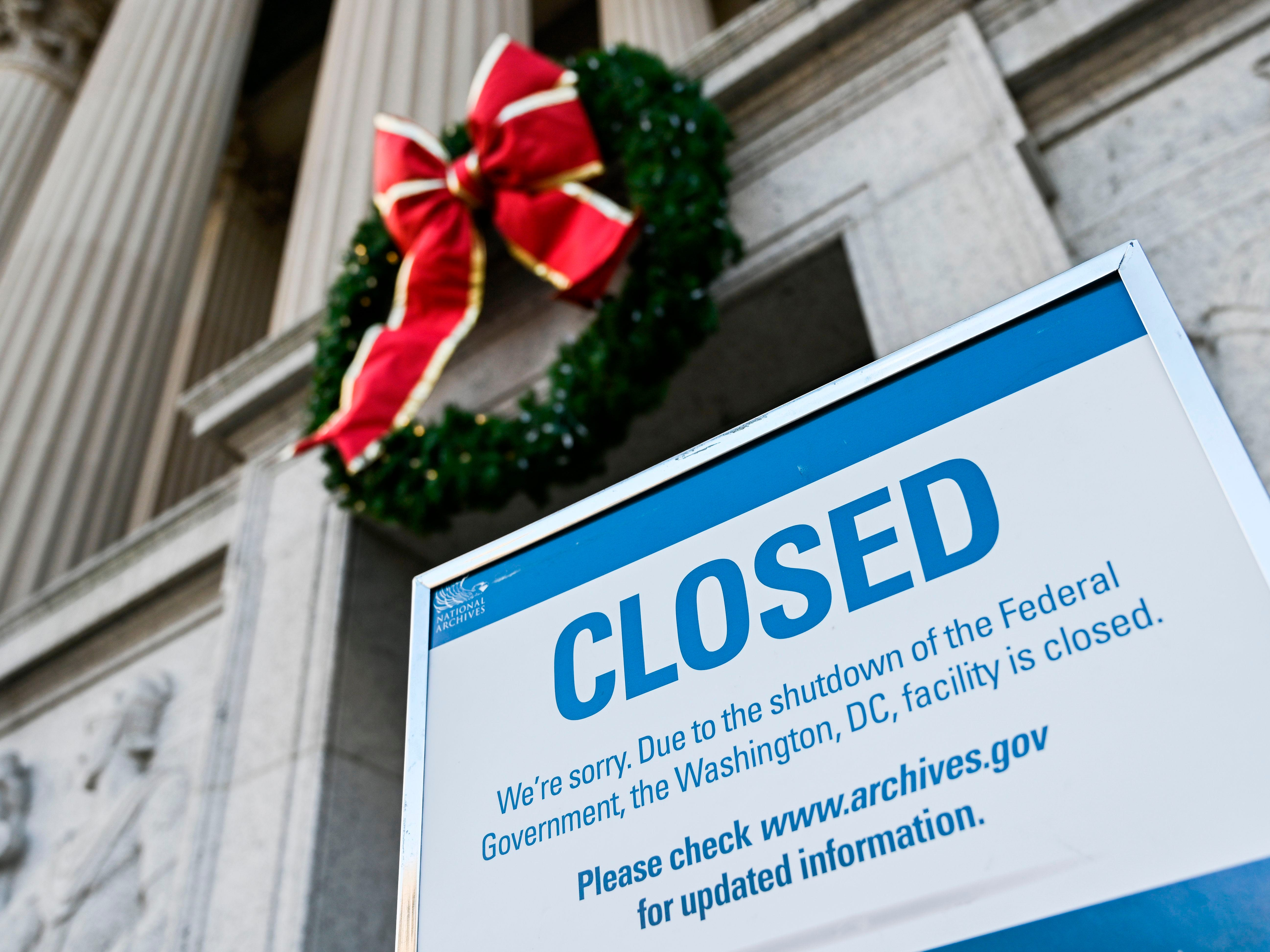 A sign is displayed at the National Archives building that is closed because of a US government shutdown in Washington, DC, on December 22, 2018. - The partial US government shutdown is set to stretch on through Christmas as the Senate adjourned with no deal to end it in sight.