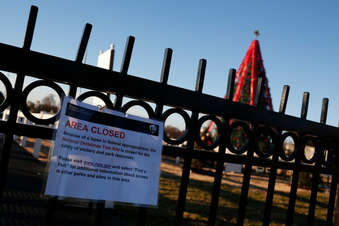 The gates to the National Christmas Tree are closed to the public due to a partial shutdown of the federal government on December 24, 2018 in Washington, DC. The partial shutdown will continue for at least a few more days as lawmakers head home for the holidays as Democrats and the Trump administration cannot agree on an amount of funding for border security.