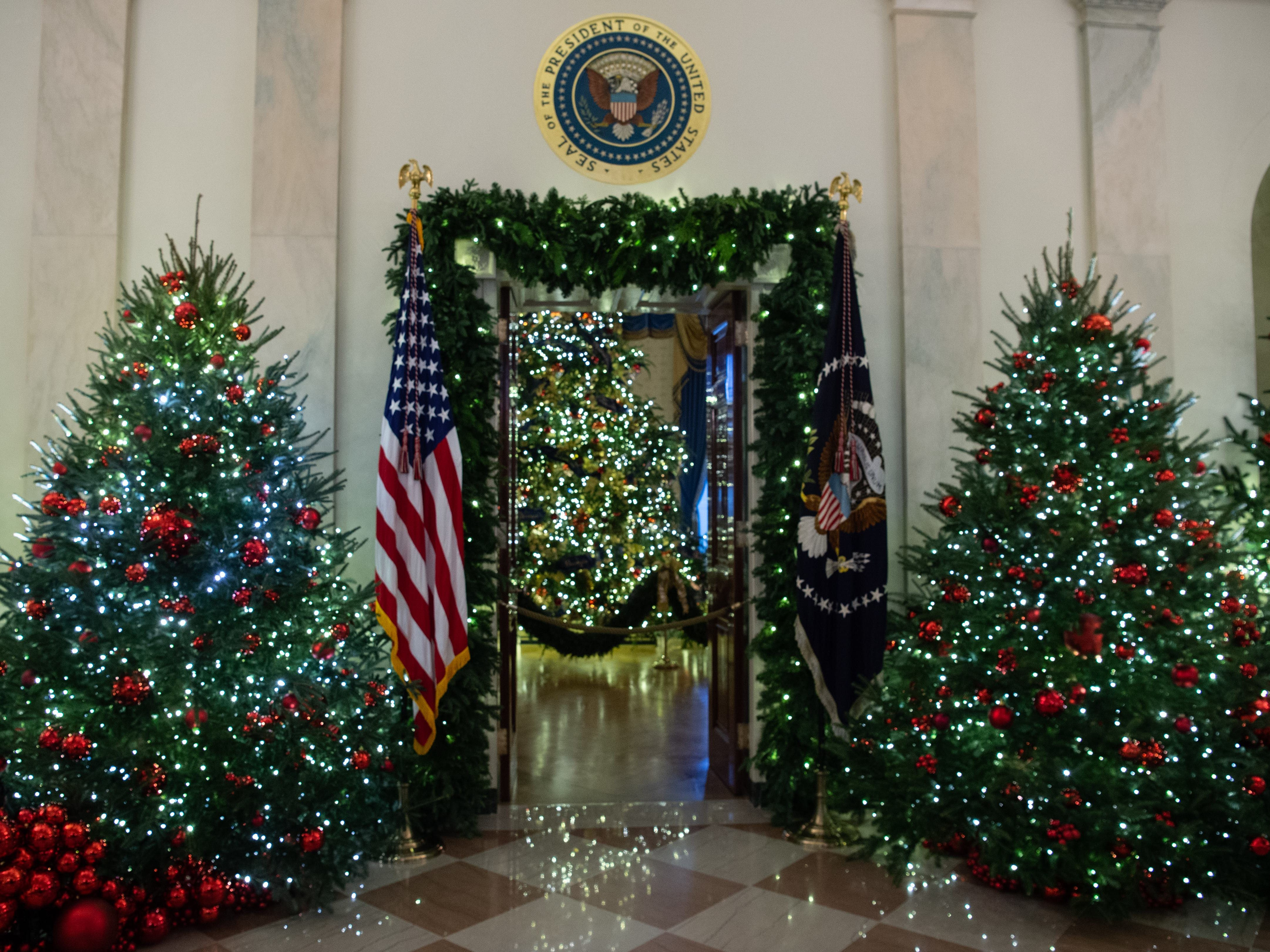 Christmas decorations are seen at the White House during a preview of the 2018 holiday decor in Washington, DC, on November 26, 2018.