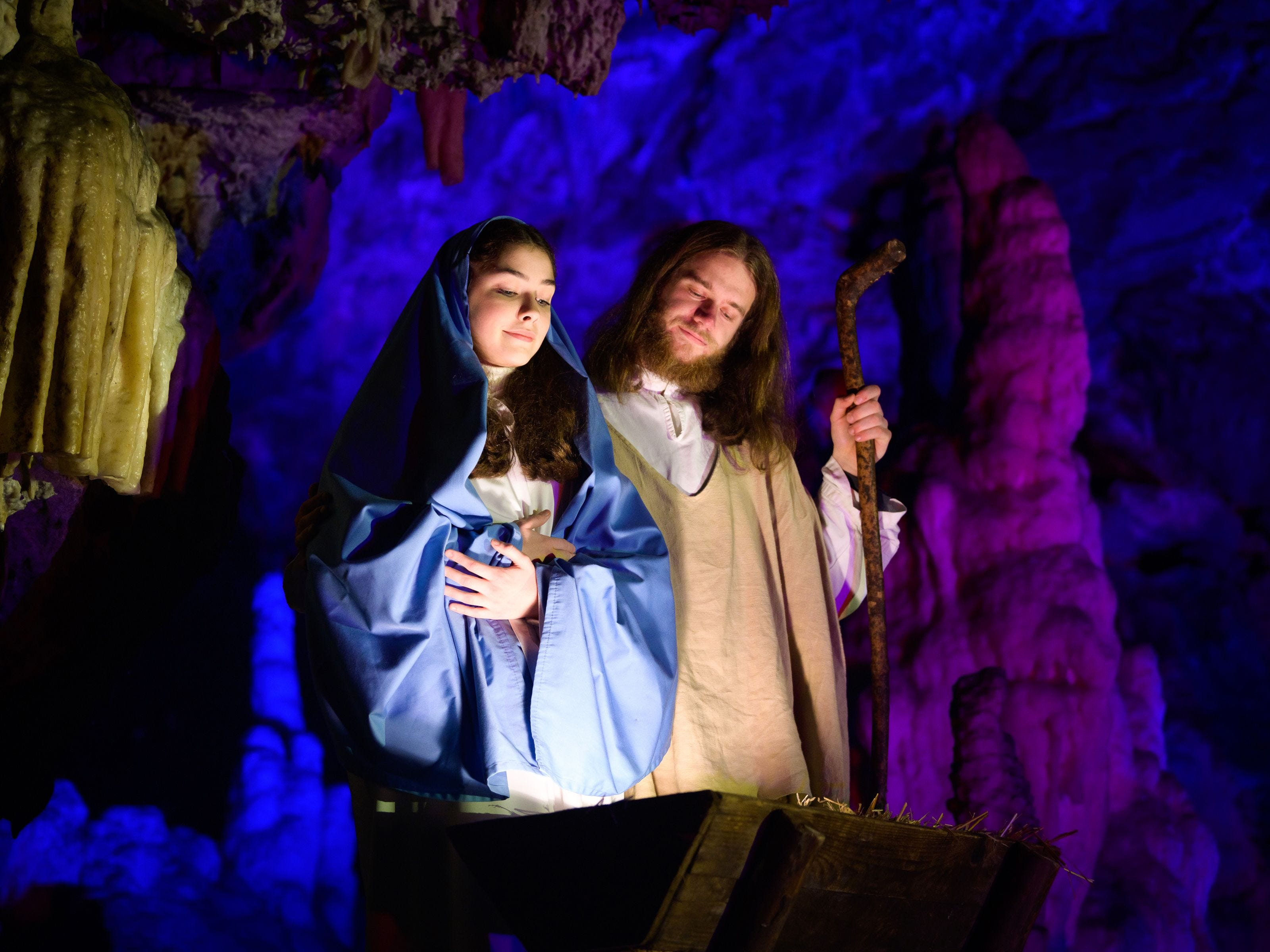 Amateur actors perform as Virgin Mary and Joseph during a Live Nativity Scene set in the Postojna Cave on December 20, 2018 in Postojna.
