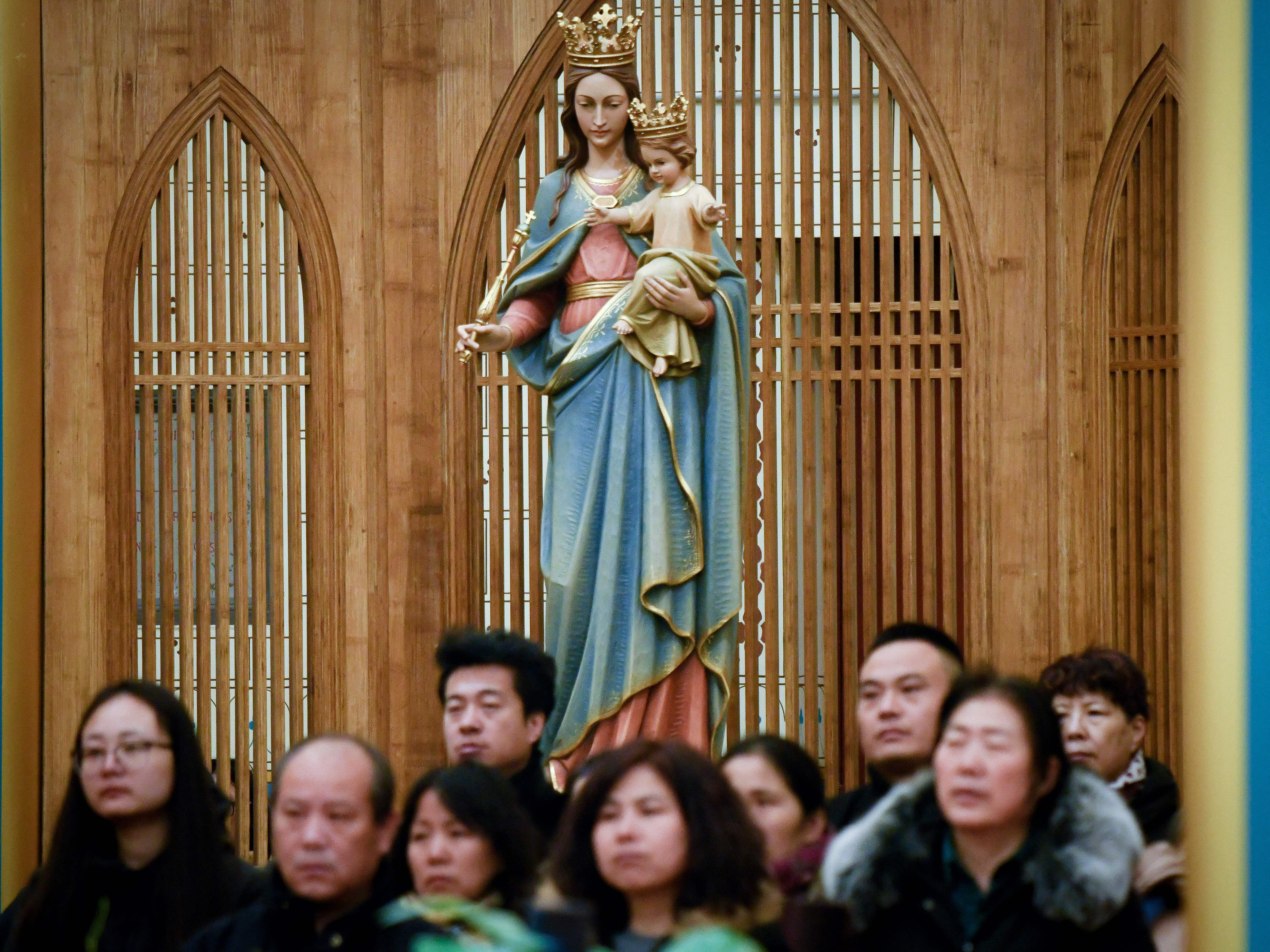Chinese worshippers attend a mass during the Christmas Eve at a Catholic church in Beijing on December 24, 2018.