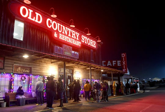 A line forms outside of the Old Country Store, Monday morning, for the 34th Annual Christmas Eve Breakfast. People began lining up around 3:30am to be the first in line for when the doors opened at 5:30am.