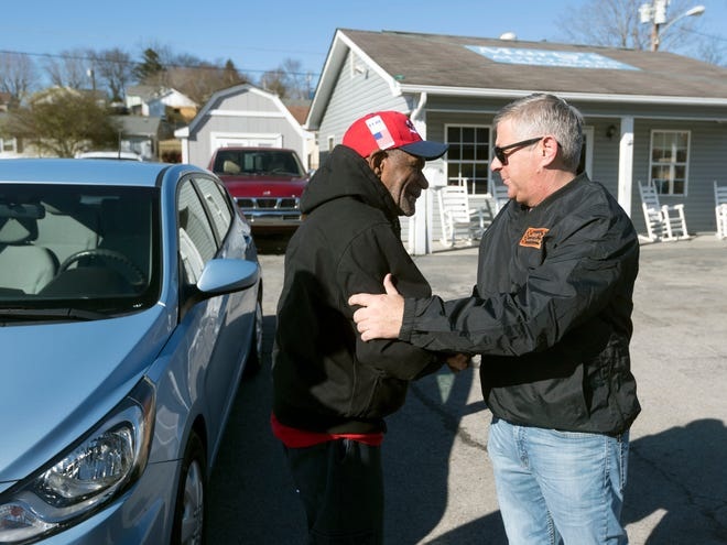 """Glenn """"Lefty"""" Miller is thanked by Marty Fugate of Mary Auto Sales on Monday, December 24, 2018."""