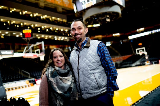 University of Tennessee Assistant Athletics Director for Communications Tom Satkowiak and his wife Brooke pose for a photo together in Thompson-Boling Arena in Knoxville, Tennessee on Friday, December 21, 2018.