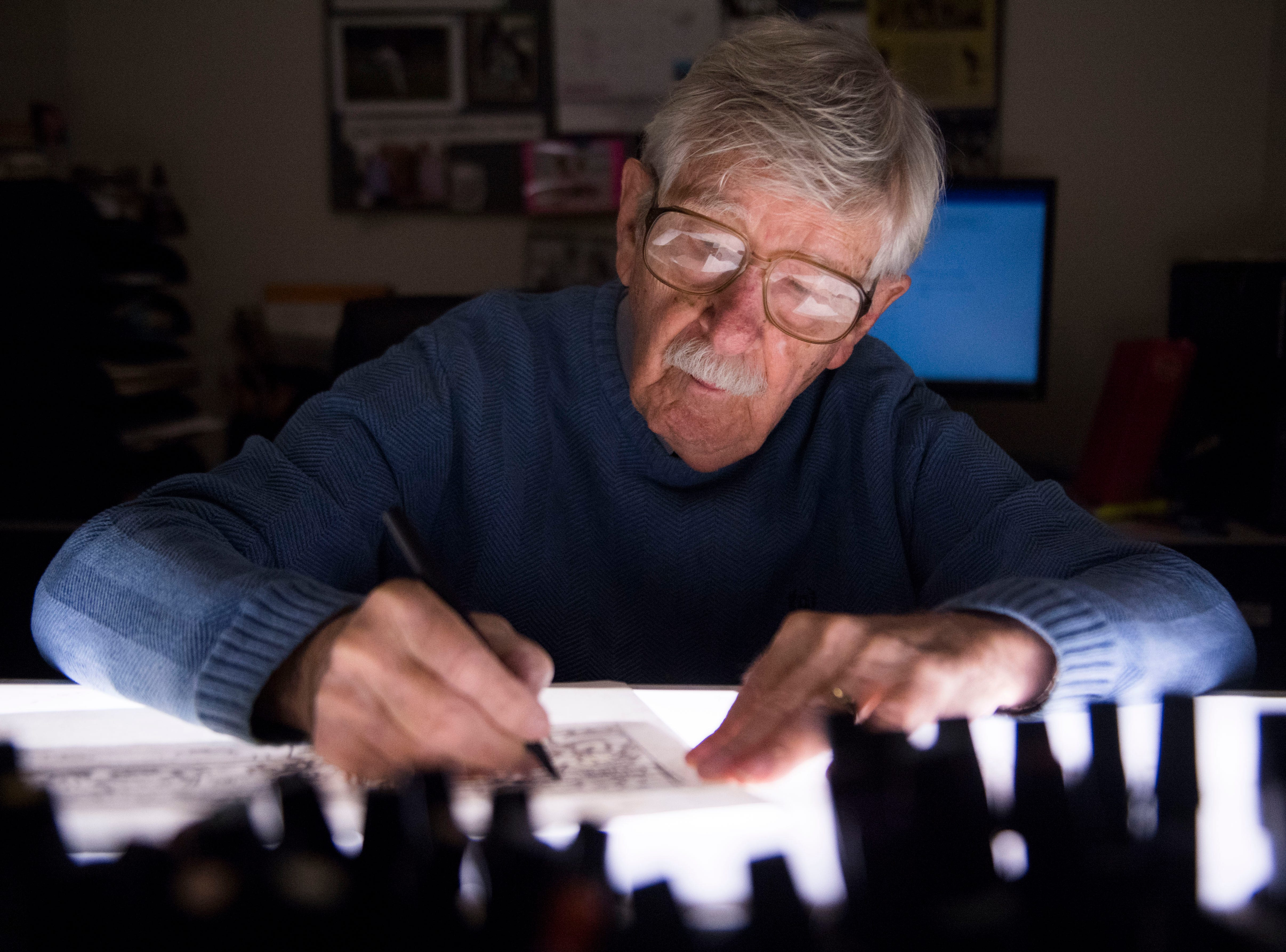 Charlie Daniel at his light table, 2018.
