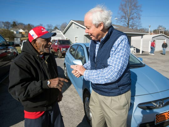 """Mobile Meals volunteer Glenn """"Lefty"""" Miller laughs with Doug Horne after Miller was was presented with a 2014 Hyundai Accent by Horne on Monday, December 24, 2018 at Marty Auto Sales in Lenoir City. Miller is a long-time volunteer for Mobile Meals but recent troubles his vehicle has left him unable to deliver meals for the program."""