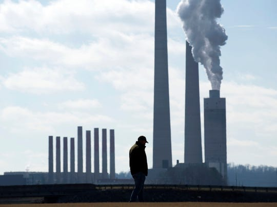 With the TVA Kingston Fossil Fuel Plant in the background, Brian Thacker stands at the Swan Pond Sports Complex on Saturday, December 22, 2018 on the 10th anniversary of the Plant's coal ash spill. Thacker, who operated a dredge and heavy machinery, joined hundreds of other coal ash clean up workers, family, and friends to honor the more than 30 dead and 250 sick or dying coal ash disaster relief workers in a memorial service.