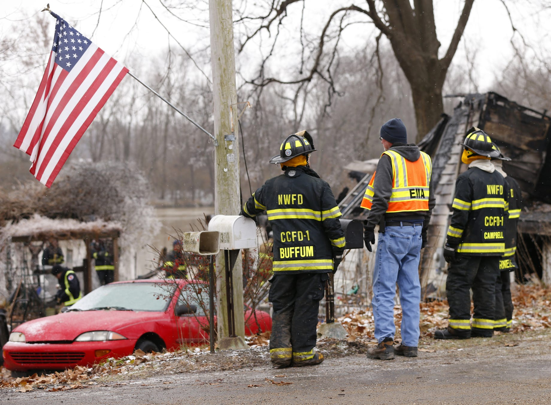 Firefighters remain on the scene following an early morning house fire that claimed several lives Wednesday, November 28, 2018, at 4300 Pottawatomie Road in Logansport.