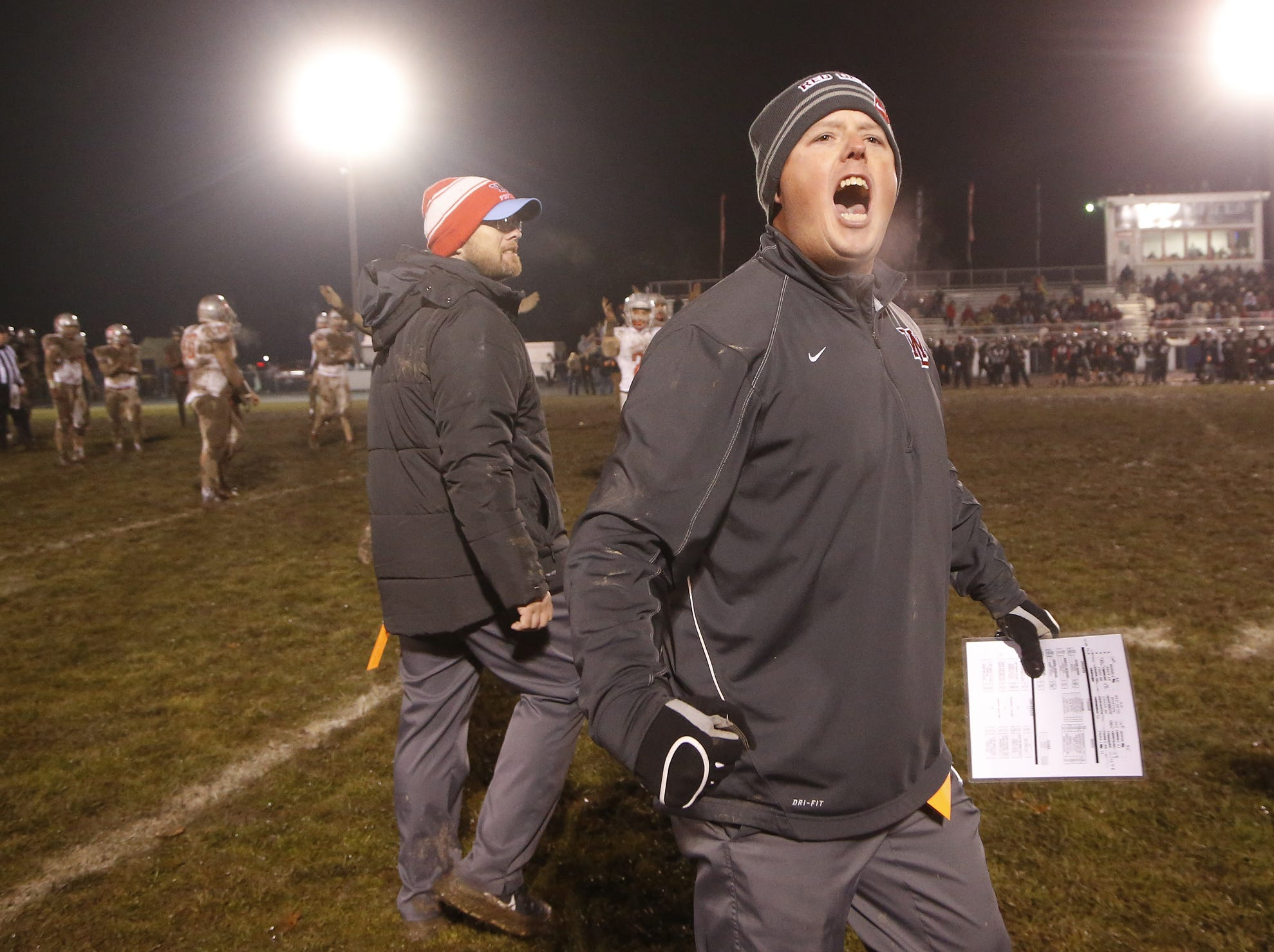 West Lafayette head coach Shane Fry turns to the Red Devils faithful and lets out a scream as time expires against Ft. Wayne Bishop Luers Friday, November 16, 2018, in Ft. Wayne. West Lafayette scored 27 unanswered points in the second half to come from behind and defeat Bishop Luers 27-14.