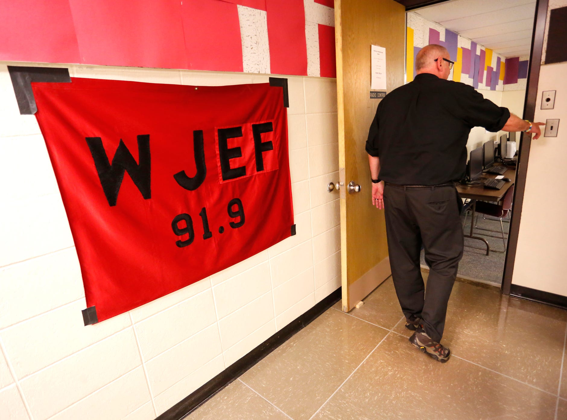 Randy Brist reaches to turn off the lights as he walks out of the studios of Jeff 92 Wednesday, May 2, 2018, at Lafayette Jeff. Brist is retiring after 34 years as director of Jeff's High School Radio & TV