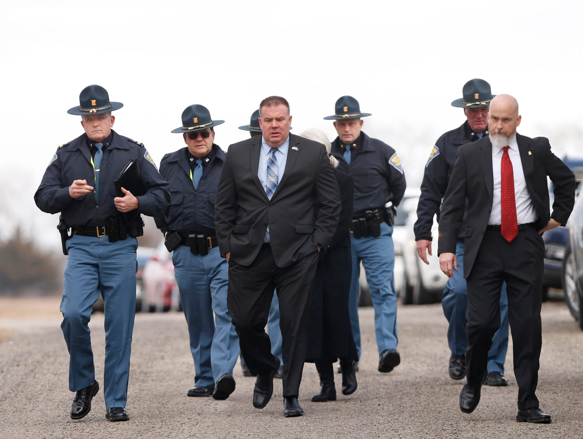 Indiana State Police Superintendent Doug Carter, far left, and other members of ISP arrive for a press conference to address the latest on the investigation into the murder of Liberty German and Abigail Williams Tuesday, February 13, 2018, at the trail head of the Monon High Bridge Trail just east of Delphi. German and Williams were murdered February 13, 2017, as they hiked the Monon High Bridge Trail.