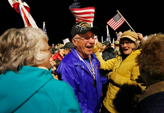 Ron Anliker is greeted by family and friends as the final Honor Flight arrives Tuesday, October 16, 2018, at Purdue Airport. Anliker, who is from Demotte, is an Army veteran of the Vietnam War.