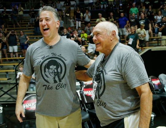 Gold team coach Matt Painter shares a laugh with Gene Keady, coach of the Black team, following the Purdue Alumni basketball game Saturday, August 4, 2018, at Mackey Arena. Keady's Black team defeated the Gold 101-91.