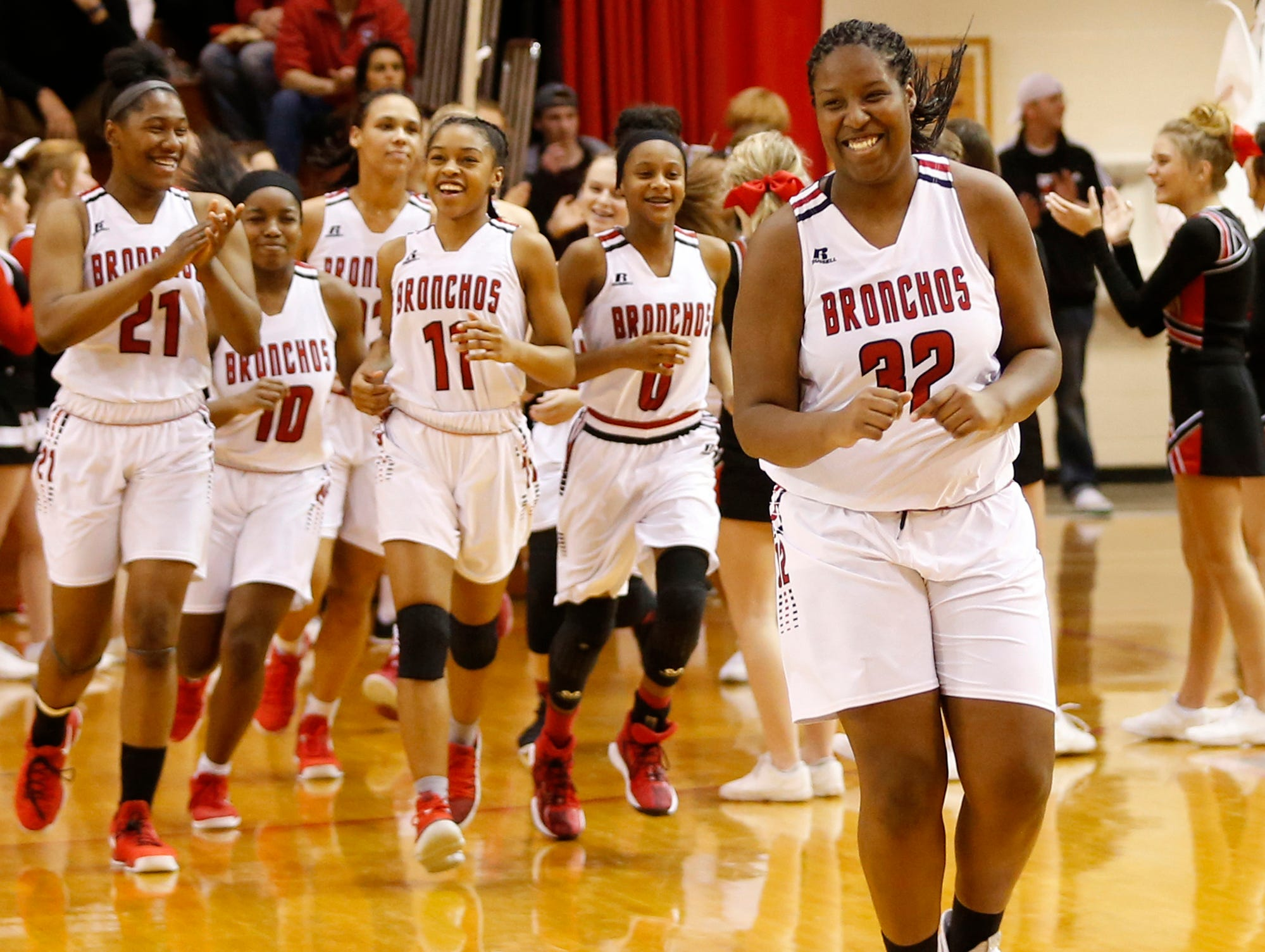 Destinee Cross, the lone senior on Lafayette Jeff's team, leads the Bronchos on the floor to face Central Catholic Tuesday, January 23, 2018, at Lafayette Jeff. Jeff defeated CC 73-62.