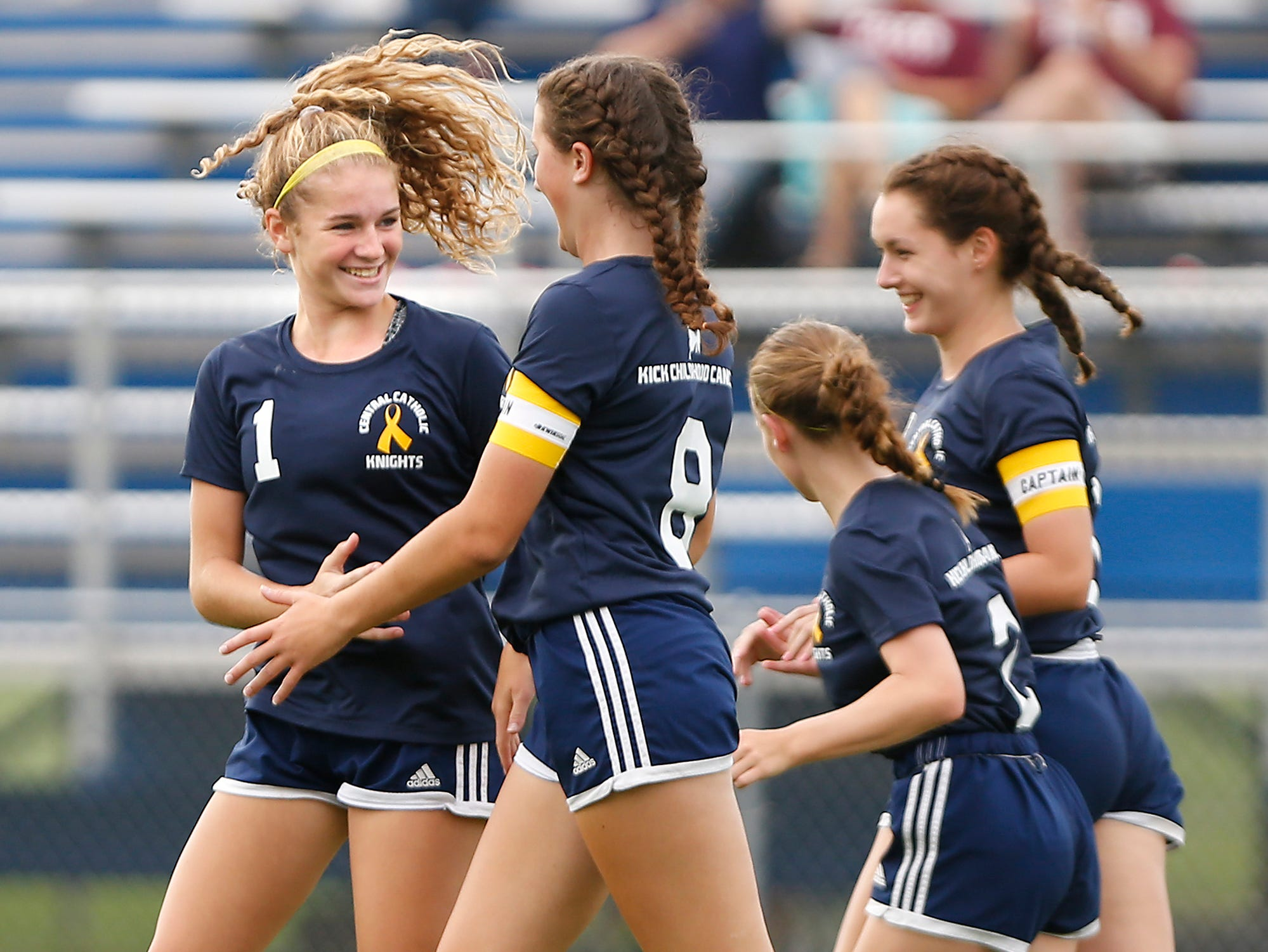 Karsyn Cherry, left, celebrates with Emma Bullock and her Central Catholic teammates after scoring at 35:50 in the second half to put the Knights up 4-1 over Faith Christian Tuesday, August 21, 2018, in Lafayette. Cherry had a hat trick as CC defeated Faith 7-1.