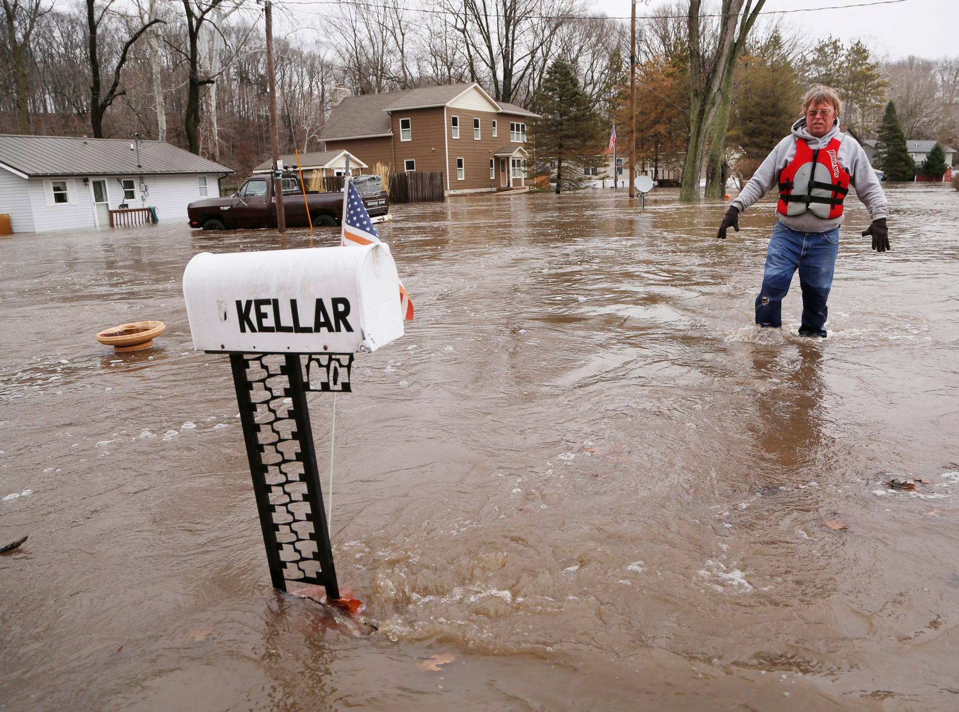 Dennis Kellar carefully walks through flood waters from his house at 11178 Horseshoe Bend Road Wednesday, February 21, 2018, near Brookston. Kellar's house next to the Tippecanoe River has been flooded several times, but he said this time may actually give him reason to move away.