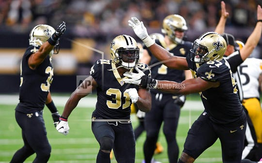 New Orleans Saints defensive back Chris Banjo (31) celebrates a defensive stop in the second half of an NFL football game against the Pittsburgh Steelers in New Orleans Sunday.