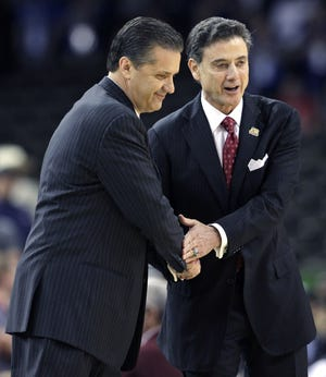 Louisville head coach Rick Pitino, right, shakes hands with Kentucky head coach John Calipari before the first half of an NCAA Final Four semifinal college basketball tournament game in New Orleans.