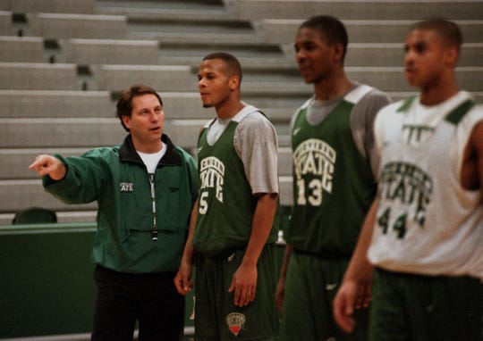 MSU basketball coach Tom Izzo, in his first season, discusses a play with Ray Weathers during practice as teammates Antonio Smith, center, and David Hart look on.