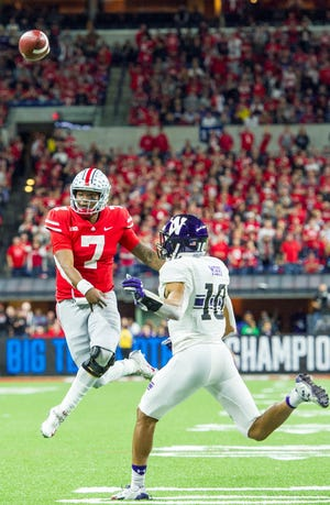 Ohio State quarterback Dwayne Haskins throws a touchdown pass on the run in the 45-24 Big Ten Championship Game victory over Northwestern.