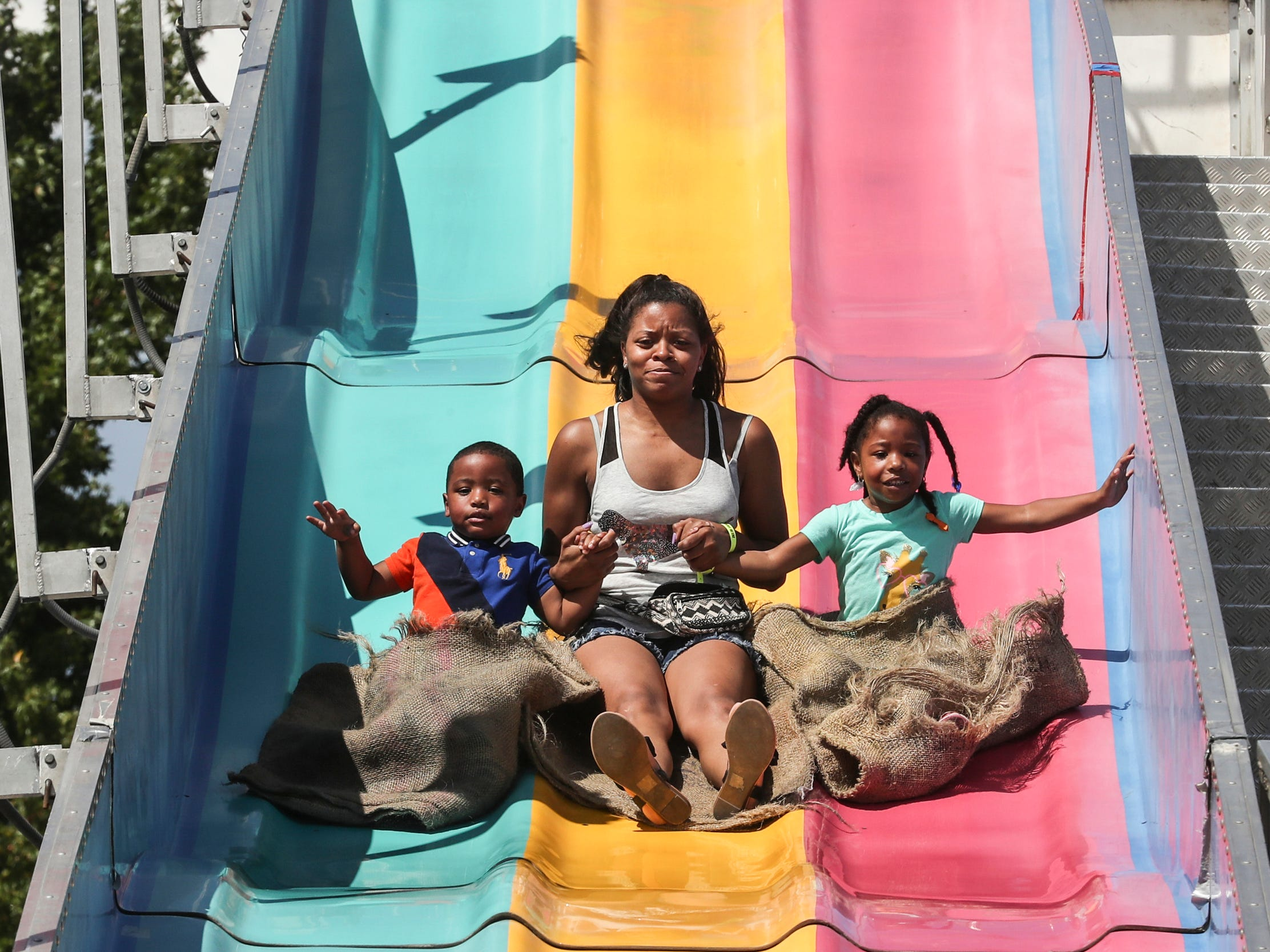 September 02 2018 - Riders head down a slide while at the Delta Fair at the Agricenter. The Delta Fair runs through September 9.