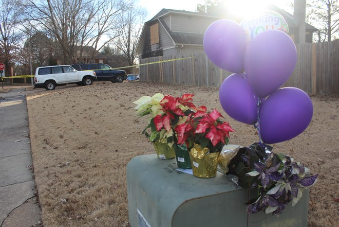 Residents left balloons and flowers outside of the Coudriet home where a mother and two teen sibling missionaries were pronounced dead during a house fire on Monday, Dec. 24, 2018.