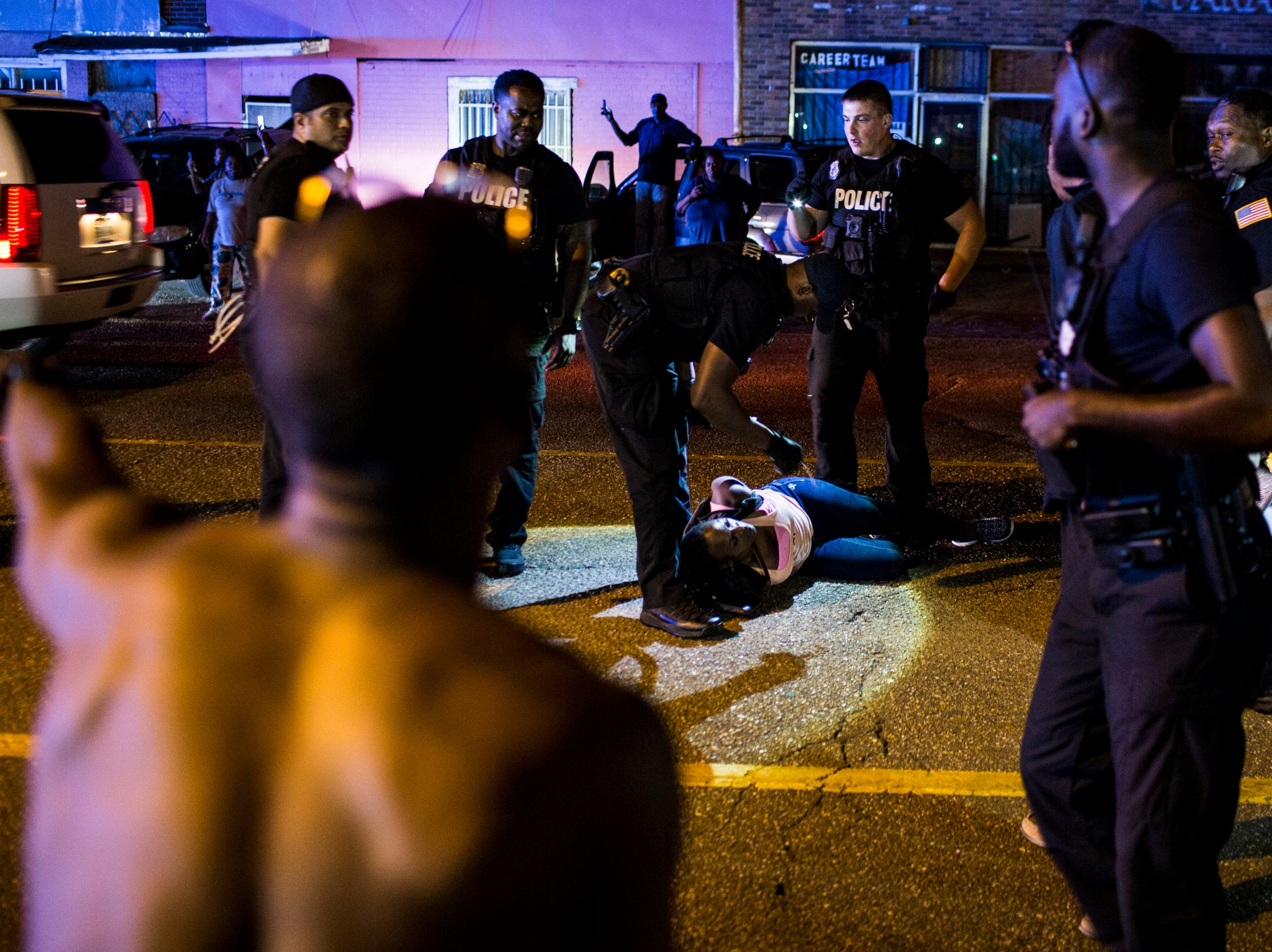 September 19 2018 - Barbara Burress who was part of a protest against the officer-involved shooting of Martavious Banks is arrested along Elvis Presley Boulevard. Protestors had shut down traffic along Elvis Presley near the site of the shooting after news that officers involved in the shooting of Banks may have improperly switched off their dashboard or body cameras, or didn't turn them on.