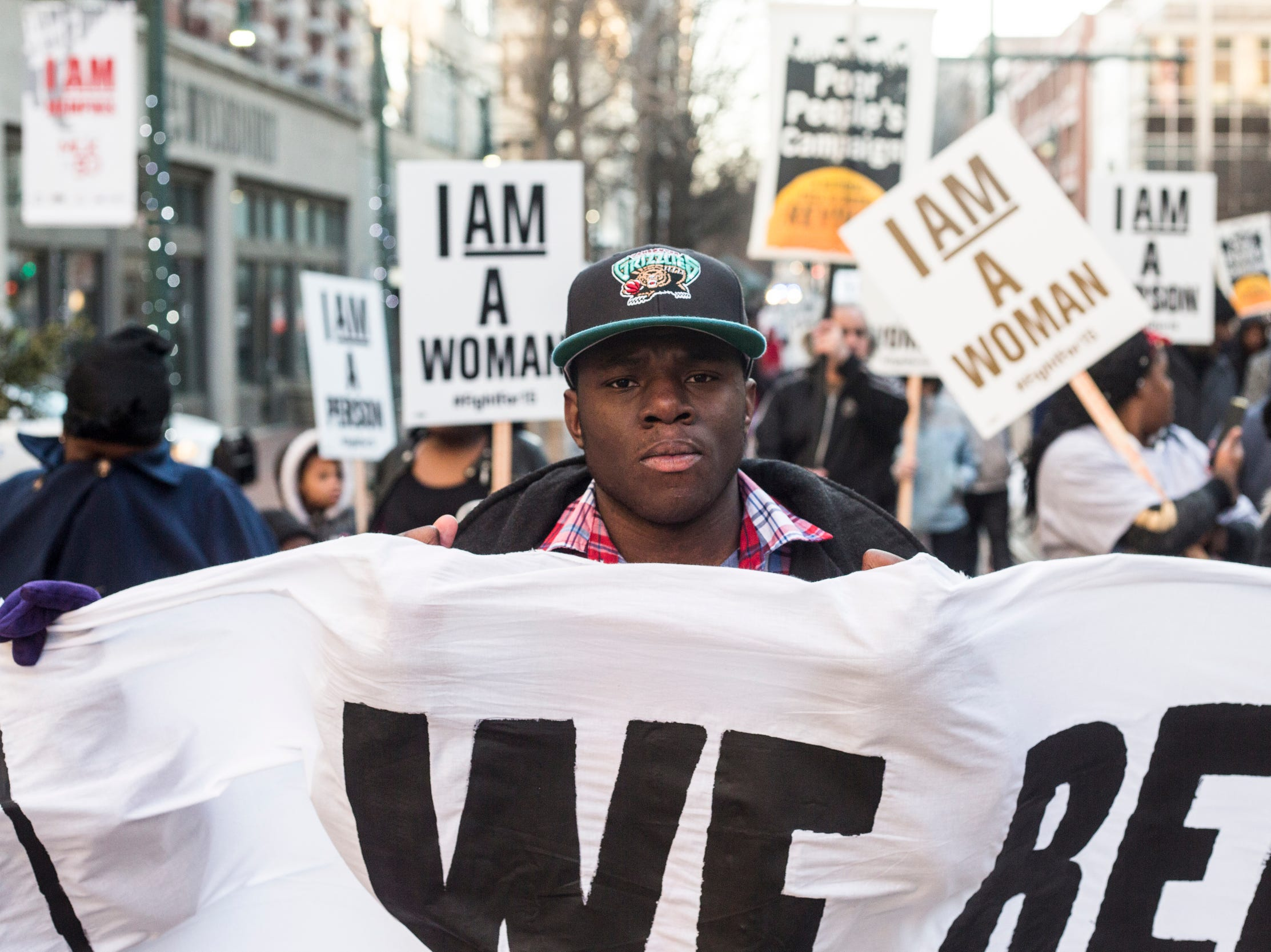 """February 12, 2018 - Ricky Epps marches towards Memphis City Hall, following the same route taken by striking city sanitation workers 50 years before. A large crowd of people organized by the group Fight for $15 marched from Clayborn Temple to City Hall waving """"I Am A Man"""" and """"I Am A Woman"""" Signs and chanting slogans."""